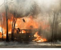 Wildfire roars into California...