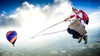 Daredevils take to skies to swing from hot air balloons