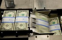 FOREX-Dollar boosted by robust U.S. housing data, pound solid