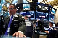 Wall St little changed as investors assess earnings
