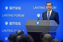 China courts India over South China Sea