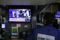 Dollar falls, U.S. stocks end higher after Trump inauguration