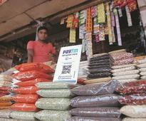 Kirana stores adopt technology, discount schemes to take on big rivals