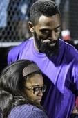 Thousands join Olympian Tyson Gay at candlelight vigil for daughter