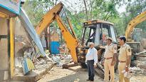 Two temples razed in dawn-to-dusk drive to reclaim mangrove land