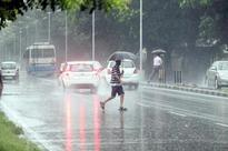 Rain leaves winding Katraj Ghat road moon-like