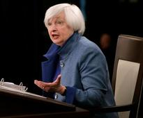 Wall Street slips on Yellen's rate hike comments