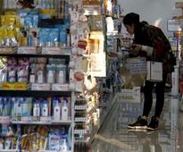 Japan consumer prices fall for second month, keep pressure on BOJ