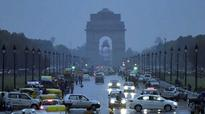 Temperature plummets in Delhi due to dust storm, light showers