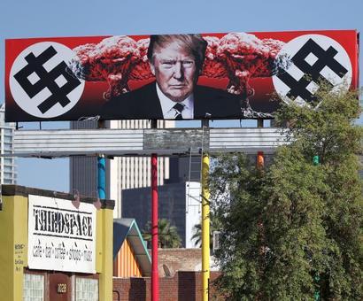 Now, a US billboard shows Trump with swastika-like symbols