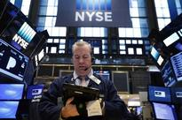 Wall Street ends choppy session higher, health lags on Trump comments