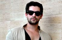 Neil Nitin Mukesh and Richa Chadda play Holi on film set