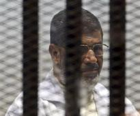 Egyptian court puts ousted president Mursi on trial over Qatar link