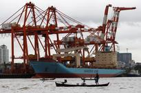 In major test, Myanmar scrambles to clear port jam threatening growth