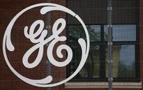 GE reports weak demand for oil, transport equipment; profit beats