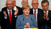 German Chancellor Angela Merkel wins fourth term with reduced vote share, say exit polls