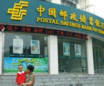China's PSBC makes tepid debut on Hong Kong bourse