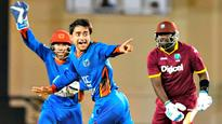 Afghanistan thrash West Indies as teenager Rashid Khan picks a seven-for
