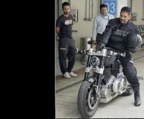 See pic: When MS Dhoni rode a policeman's bike in Zimbabwe!