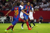 Football: Suarez gives Barca edge