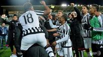Football: Buffon the hero as Juventus put one hand on title