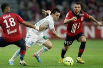 Marseille rely on strong defense in home straight