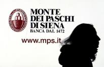 RPT-UPDATE 2-DBRS cuts Italy's credit rating, posing problems for...