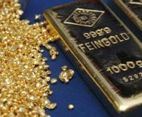 Gold edges higher