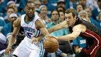 Walker leads way as Hornets tie series with Heat