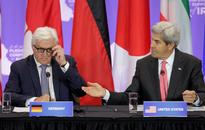 Kerry warns of new challenge in securing Iraq ... U.S. Secretary of State John Kerry (R) gestures to German Foreign Minister F...