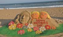 Sand Sculpture created by International sand artist Manas Kumar Sahoo on the Golden Sea Beach, Puri on the eve of Mother's Day