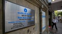 Demonetisation has and may continue to result in a slowdown: SBI