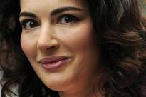 Nigella Lawson's husband downplays photos of him grabbing her neck
