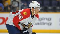 Defenseman Jonathan Racine re-signs with the Florida Panthers