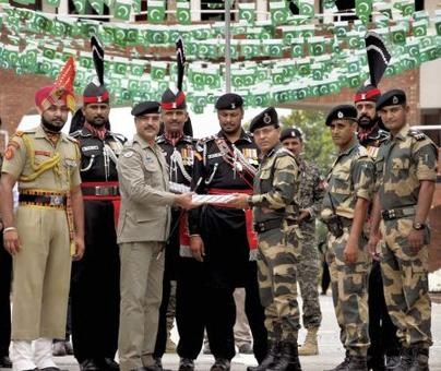 Pak Rangers offer sweets to India at Wagah border