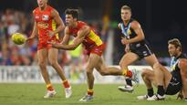 AFL player manager Colin Young angry at Jaeger O'Meara tradfe speculation