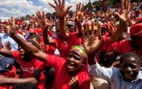 Mugabe supporters march against marches