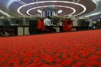 Asia stocks erase losses but some investors await Trump talk