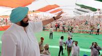 Punjab Cong feels the heat: Party down but not out, says Captain