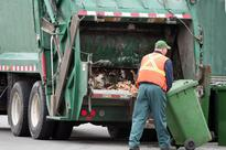 Binmen find man ASLEEP in rubbish compactor - saving him from being CRUSHED to death
