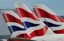 BA passengers stranded as glitch hits worldwid... British Airways logos are seen on tailfins at Heathrow Airport in west Londo...