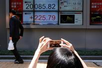 Japan's Nikkei inches up, caught in tight range before Fed meeting