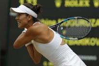 Muguruza storms into second Wimbledon final