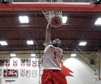 Encouraging story about Fran Belibi, who does more than dunk a basketball