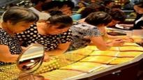 China's gold output dips on lower prices