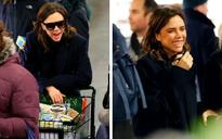 Victoria Beckham flashes a rare smile as she stocks up for Storm Stella