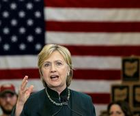 Clinton urges Republicans to join her on the American team