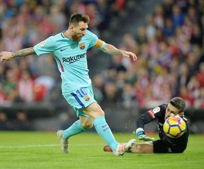 Messi scores again as Barca stay clear at the top