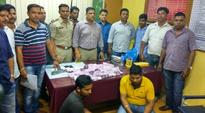 Over Rs 1.75 crores, in new currency, seized in raids at different places