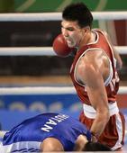 Injured Vikas settles for bronze